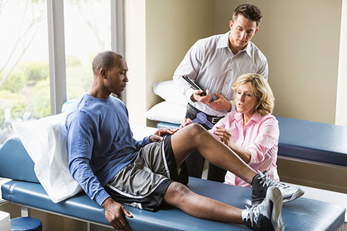 Physical therapists with a patient